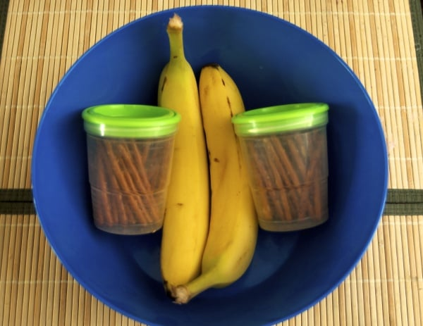 bananas and pretzels in a blue bowl
