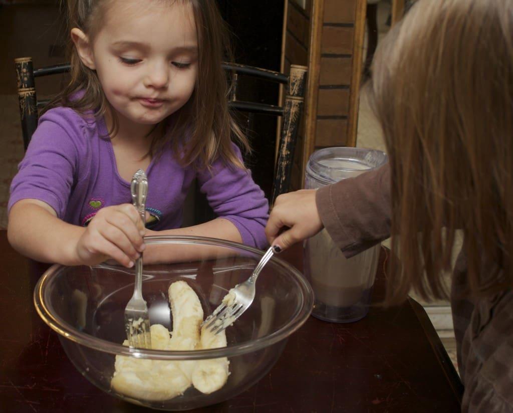 kids mashing up bananas