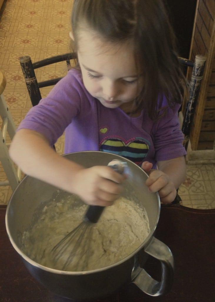 girl mixing up banana bread
