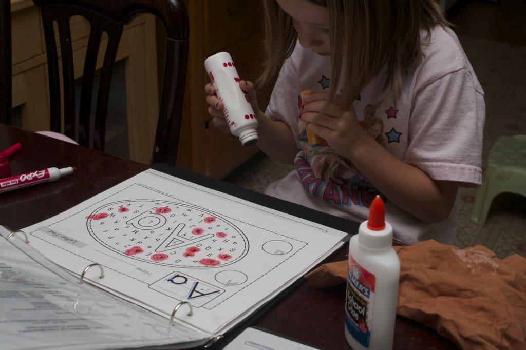 Little girl using do-a-dot markers.