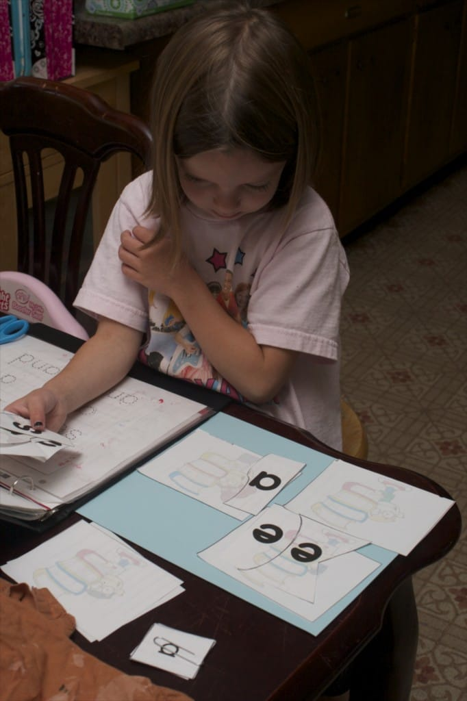 Little girl working on sight words.