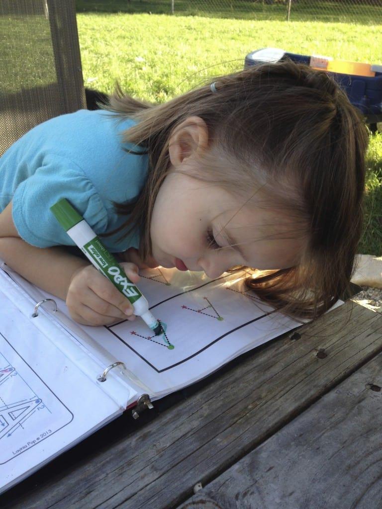 Homeschooler doing work outside on a nice day.