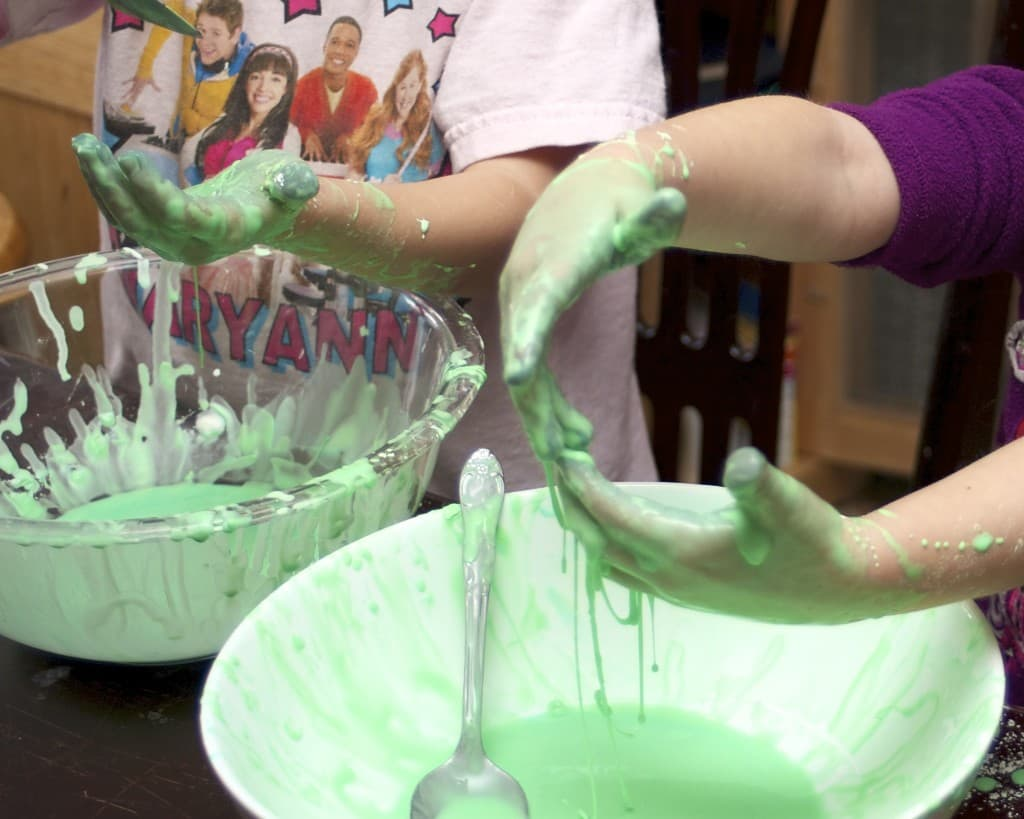kids playing with green oobleck
