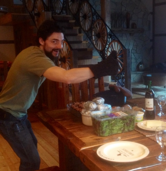 Man giving thumbs up at dinner party