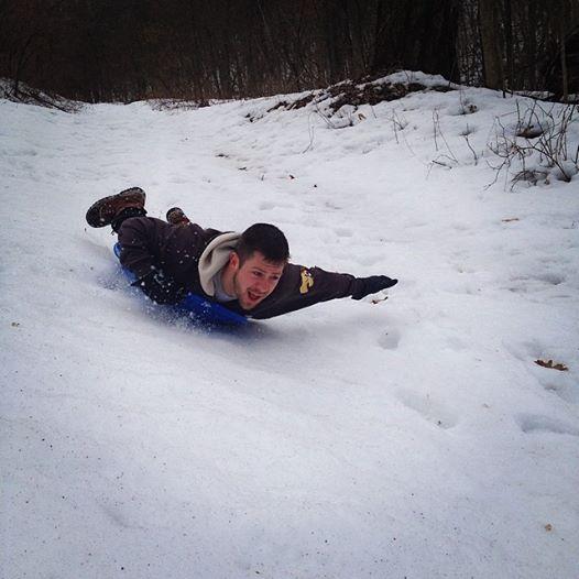 man sledding at Big Valley Ranch Avoca, WI