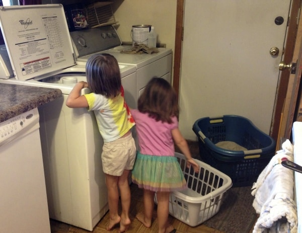 girls helping with the laundry