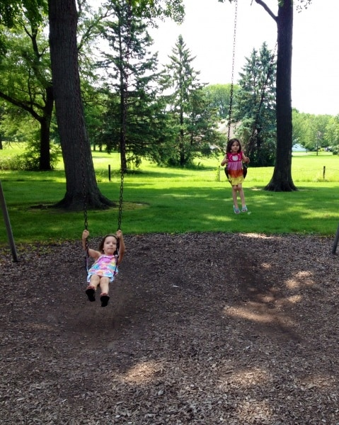 Sisters on the swings at Stoppenbach Park, Jefferson, Wisconsin