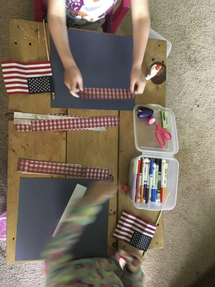 Girls crafting with scrapbook paper