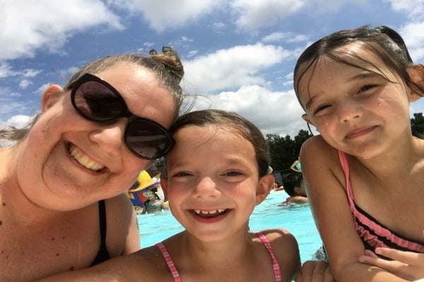 mom and daughters at the swimming pool