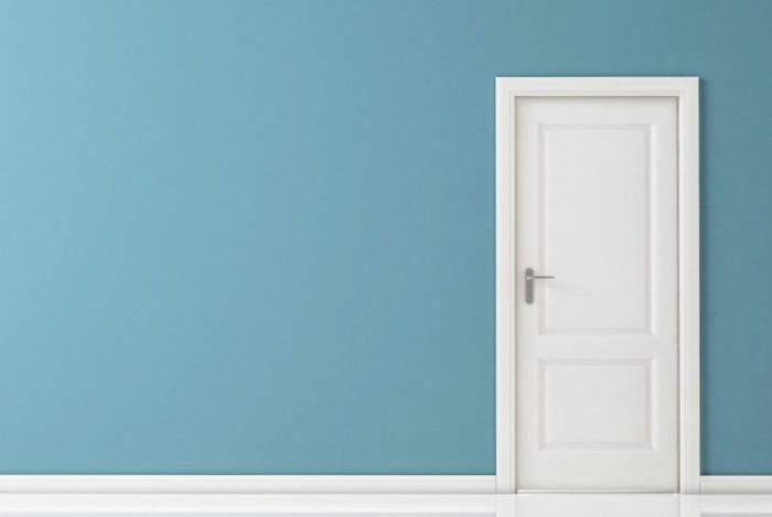 Simple blue wall with a white door.