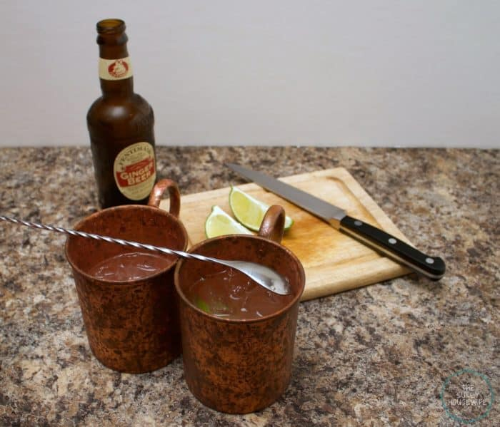 Moscow Mules in copper mugs with ginger beer and limes.
