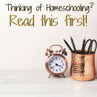 Should I homeschool featured image. Golden analog clock on a desk.