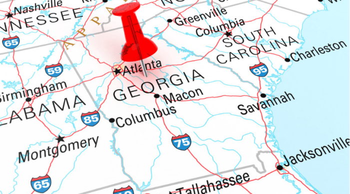 map of Georgia with a red pin in it