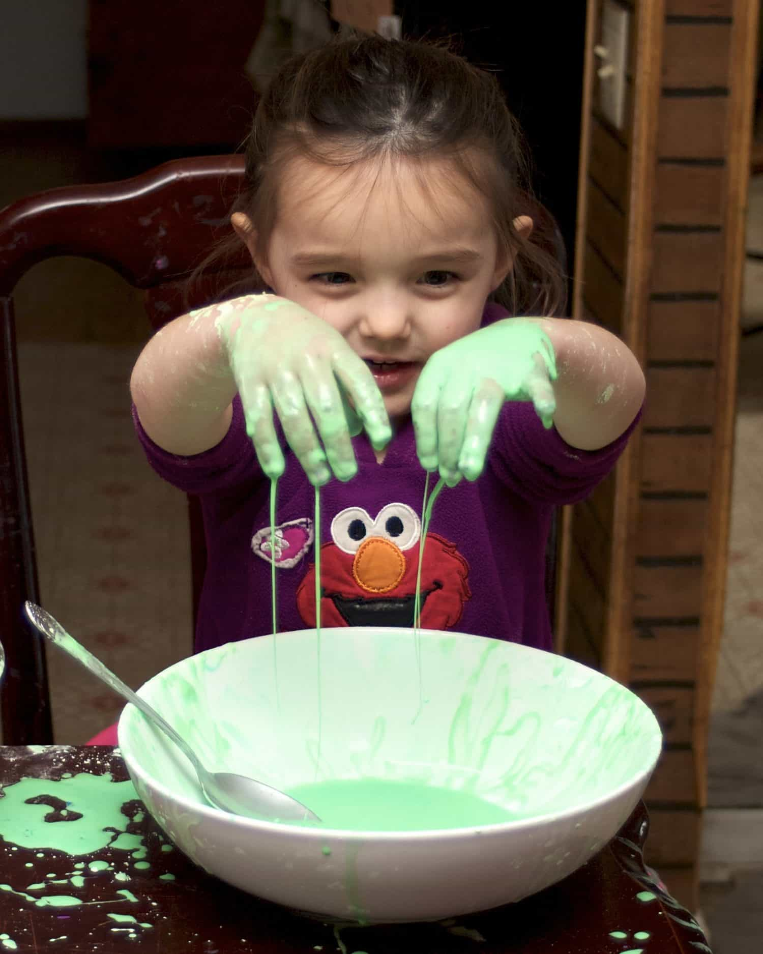 little girl playing with oobleck