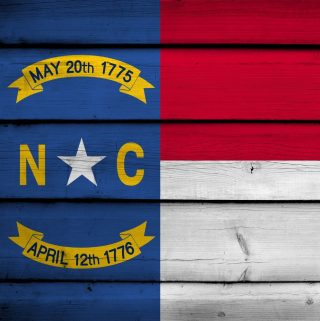 flag of North Carolina with wooden planks