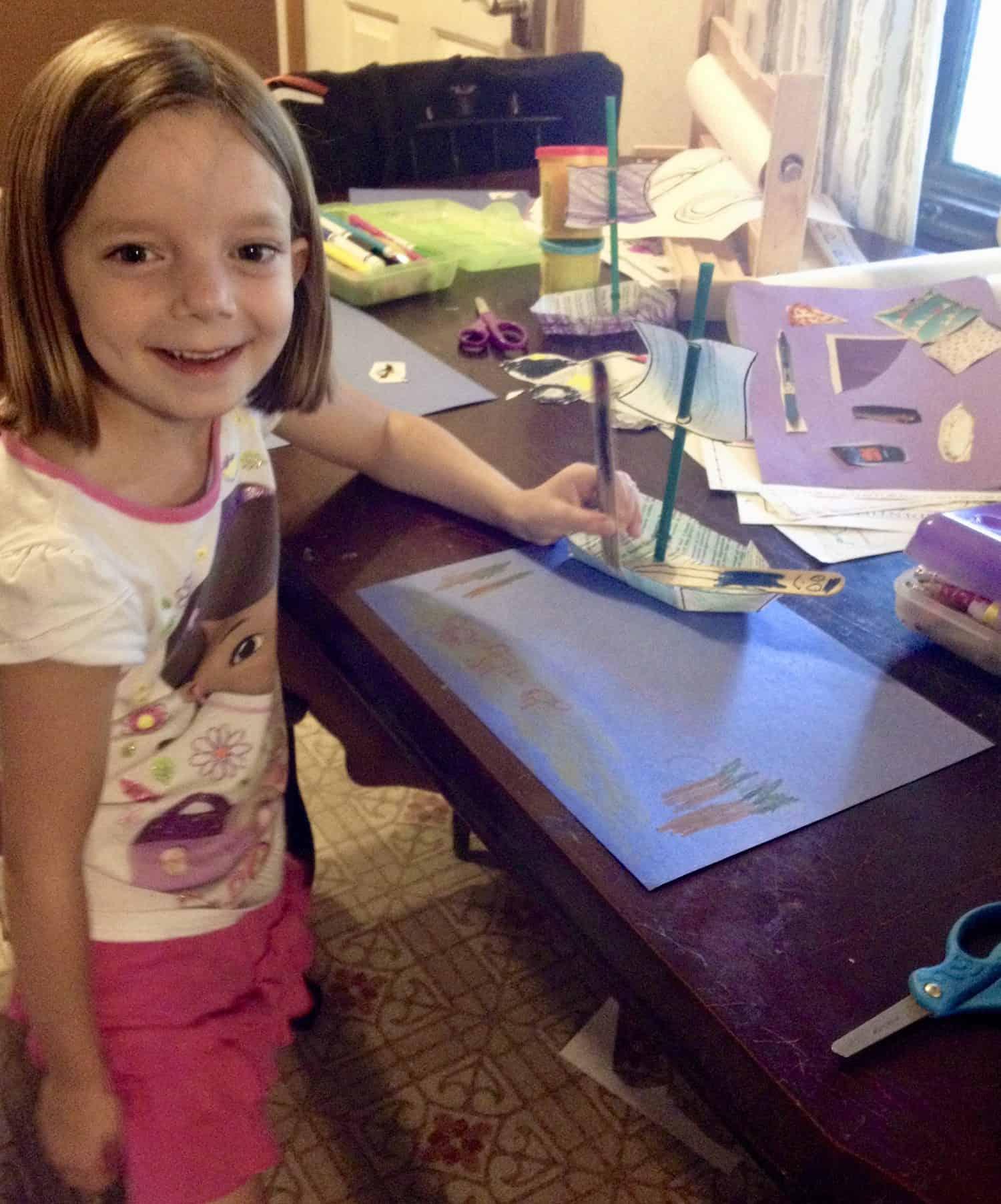 preschooler with a printable pirate ship craft