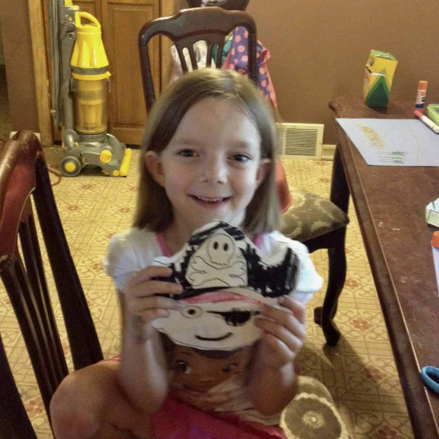 little girl with a pirate face craft
