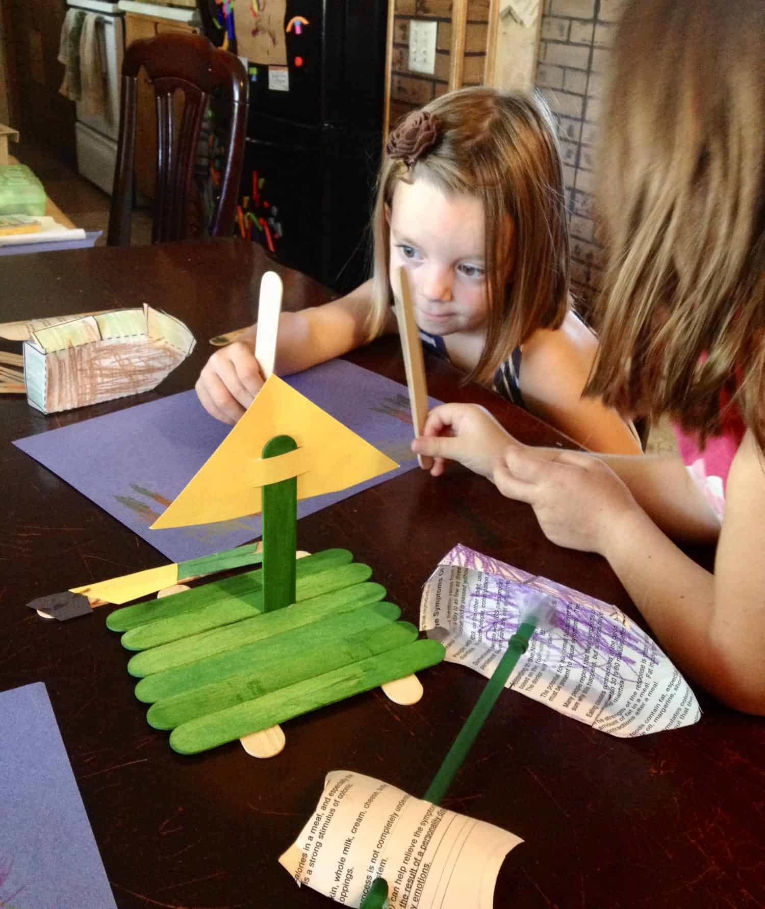 sisters playing with pirate ship crafts