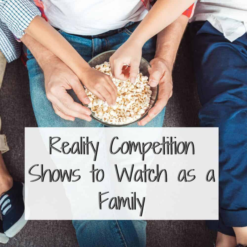 family reaching for popcorn from a bowl