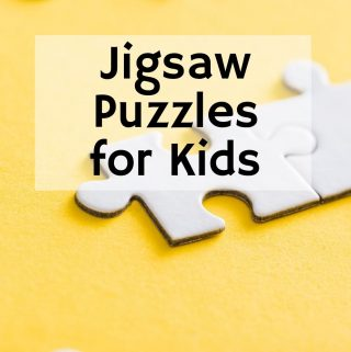 selective focus on white puzzle pieces on a yellow background. Title Image for blog post: 10 puzzles for kids to do during read aloud time