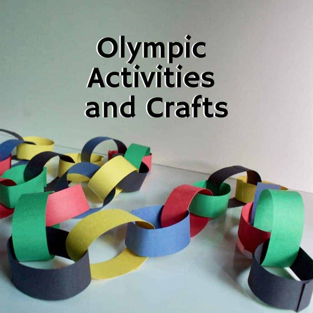 paper chain featuring the Olympic colors on a white table