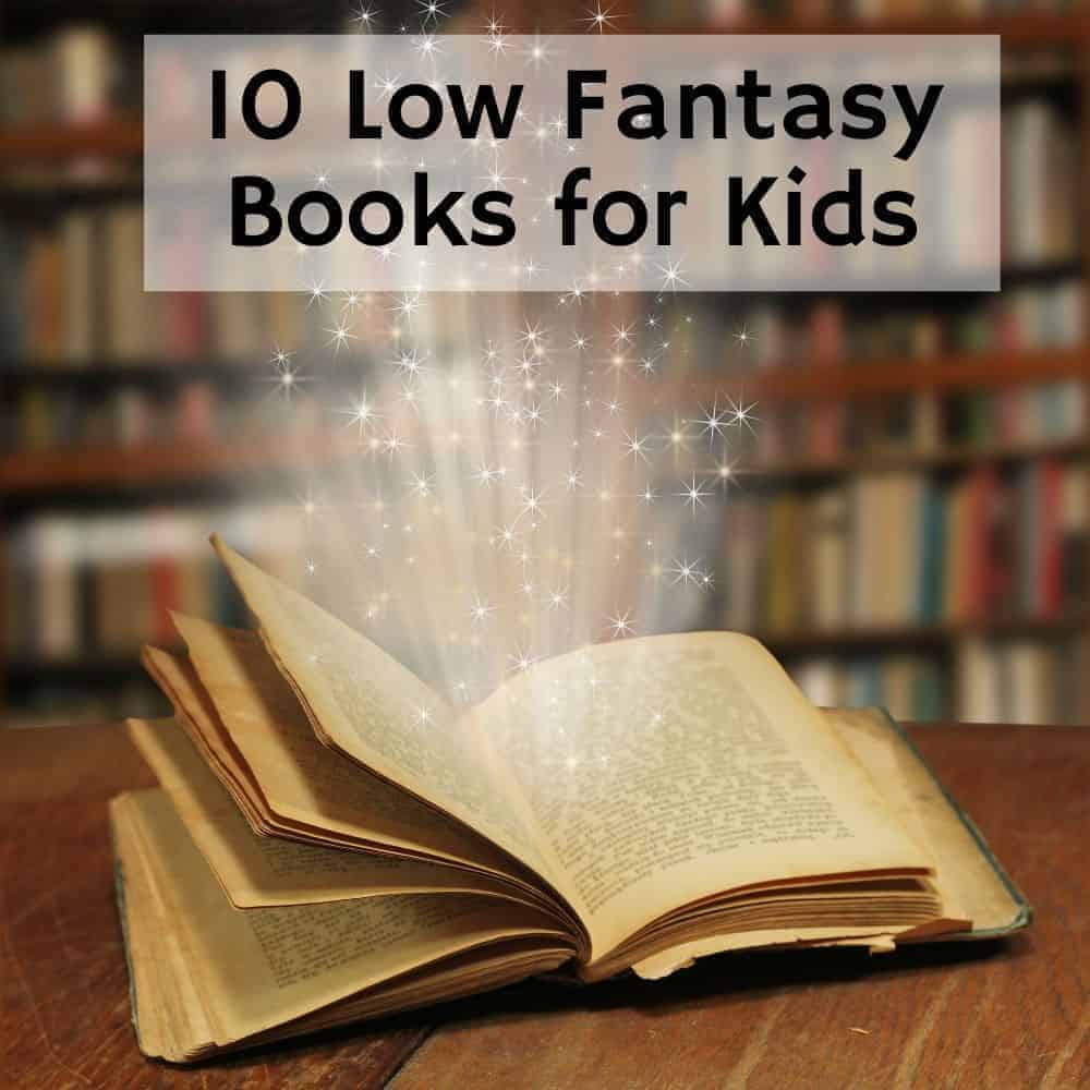old book on a table glowing with stars | Title image of blog post 10 low fantasy books for kids