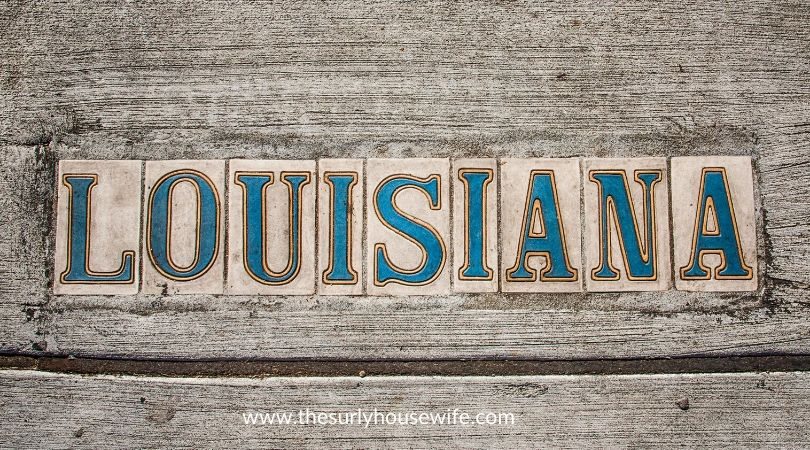 Louisiana spelled out with tiles. Title image of blog post: The Ultimate list of Children's books about Louisiana