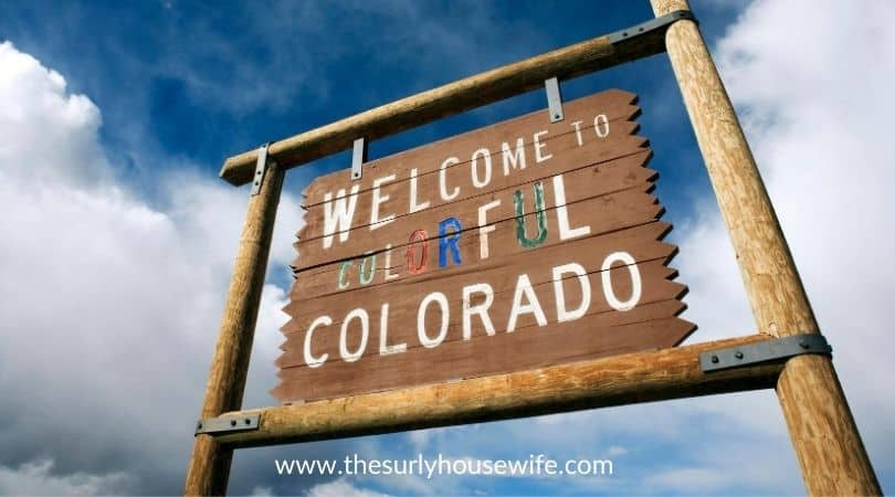 Welcome to Colorado sign. Title image to blog post 20 children's books about Colorado
