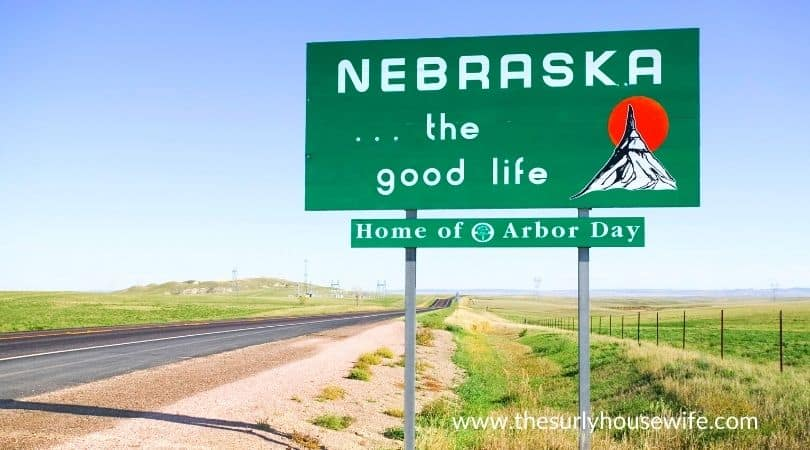 Welcome to Nebraska sign. Title image for blog post 20 children's books about Nebraska.