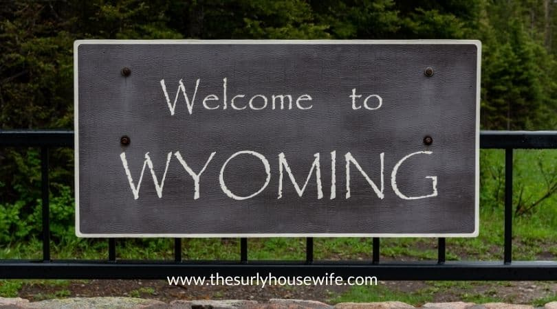 Welcome to Wyoming sign. Title image of blog post 20 children's books about Wyoming